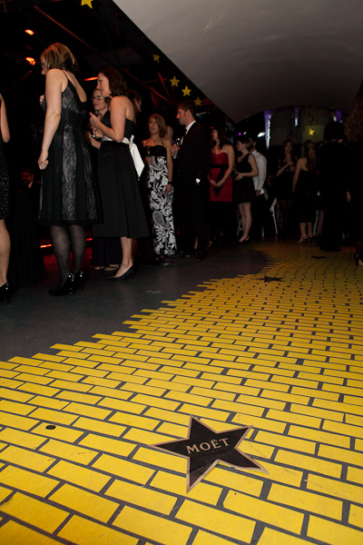 Photo of a yellow brick road with Moet on it