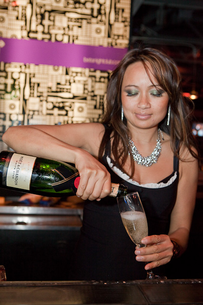 Bartender pours a glass of Moet